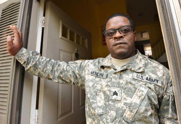 National Guard worker who has been classified as non-essential ...