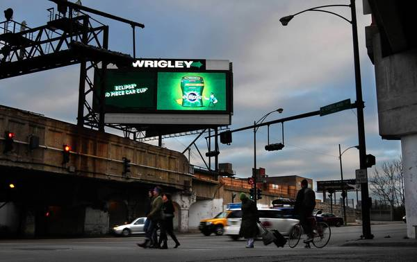 An electronic billboard glows along the Kennedy Expressway near Cortland Street and Ashland Avenue.