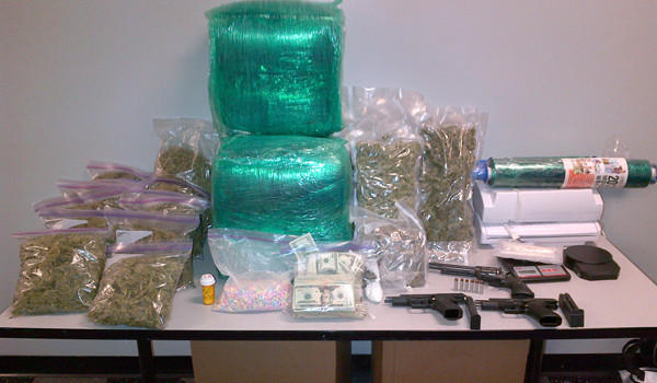 Police seized 166 pounds of marijuana, $44,000 in cash and four guns, along with ecstasy, cocaine and crystal meth, from a Southwest Side home Wednesday night.