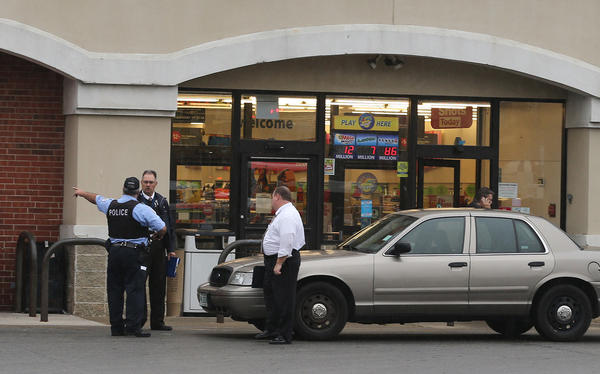 Chicago police and detectives arrive at the CVS pharmacy in the 2600 block of South Pulaski in Chicago where an off-duty Cook County officer shot at a person who was allegedly threatening a CVS employee.