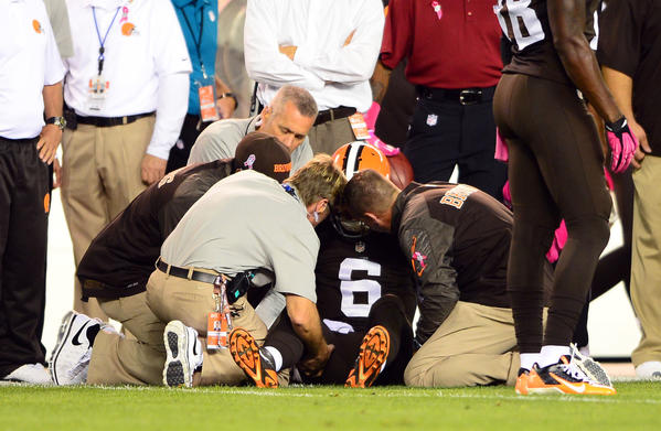 Browns quarterback Brian Hoyer is attended to by medical staff after being injured during the first quarter.