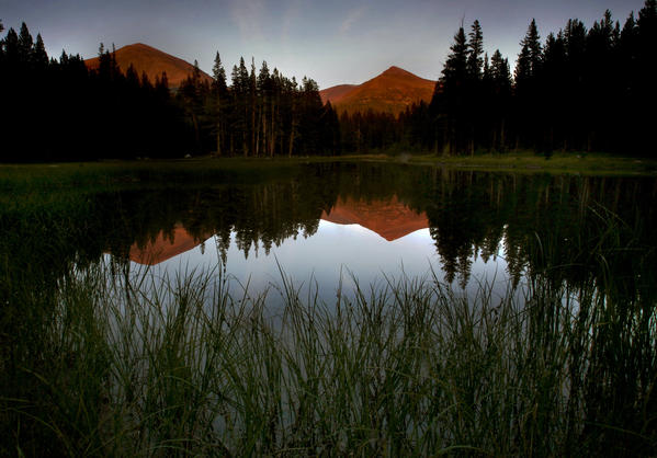 Mount Gibbs, left, and Mount Dana are reflected in a lake in Tuolumne Meadows in Yosemite National Park. The park has been closed by the government shutdown that started Tuesday.