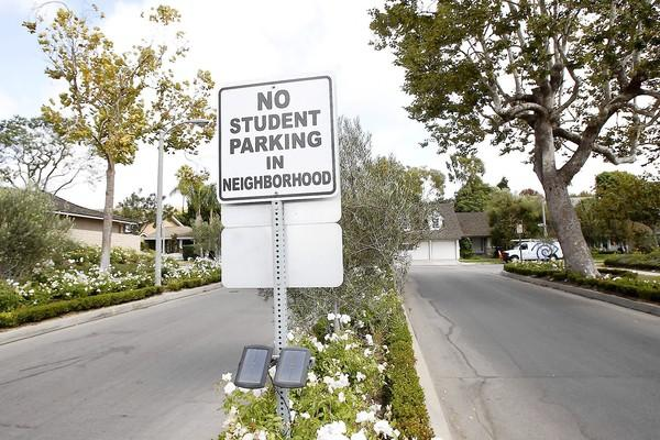 Despite a sign on Alba Street, residents are getting more unhappy that students park in front of their homes on Aralia Street across from Corona Del Mar High.