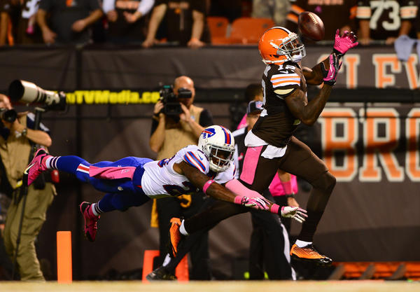 Browns wide receiver Josh Gordon catches a pass while being defended by Bills safety Aaron Williams for a touchdown during the third quarter.