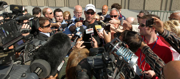 Dale Sveum speaks to the media in the Wrigley Field parking lot after being fired as Cubs manager on Monday.