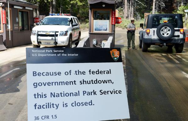 A sign at Yosemite National Park on Tuesday alerts motorists of the park's closure because of the government shutdown.