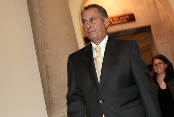 House Speaker John Boehner (R-Ohio) walks to the House floor on Thursday for a vote on legislation to partially fund some operations of the federal government.