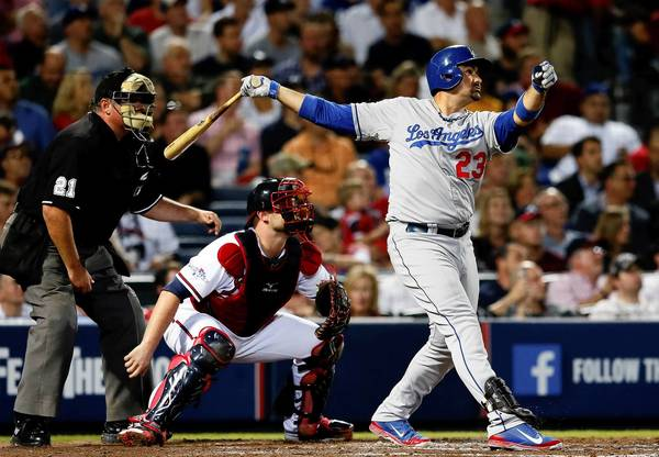 Adrian Gonzalez of the Los Angeles Dodgers hits a two-run home run in the third inning against the Atlanta Braves during Game 1 of the National League Division Series at Turner Field.