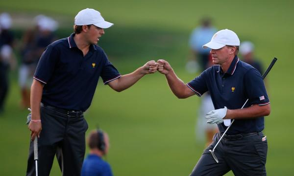Jordan Spieth, left, and Steve Stricker celebrate on the 18th hole at the Presidents Cup on Thursday.