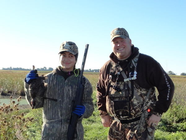 Christina Beusch, left, holds up her first duck, a drake blue-winged teal, with mentor Chris Daniels. Six youth tallied four ducks and a goose during the Jim River Marsh Masters youth hunt on Sept. 21.