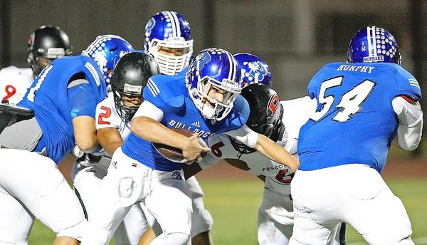 Burbank High quarterback Ryan Meredith runs the ball against Pasadena (Roger Wilson/Staff Photographer).