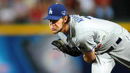 Dodgers' ace trumps Braves in postseason opener, 6-1