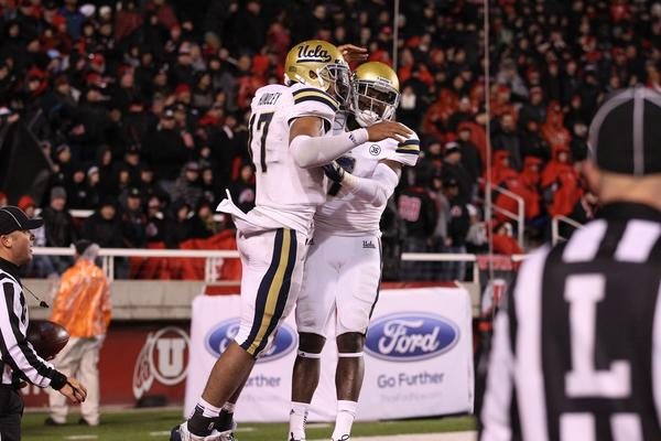 UCLA quarterback Brett Hundley celebrates with receiver Devin Fuller after a touchdown run in the fourth quarter Thursday night.