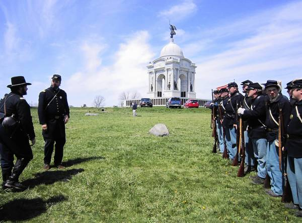 In April, Battle of Gettysburg re-enactors prepare for a staged conflict near the Pennsylvania Memorial. The federal shutdown saved the park from a plan to defile it with a Ku Klux Klan rally this month.