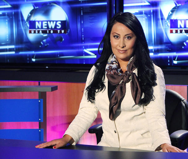 Armine Amiryan, head of the news department at USArmenia Worldwide Armenian Television in studio in Tarzana on Wednesday, Oct. 2, 2013. The station recently purchased property in Glendale and plans to relocate soon from Tarzana.