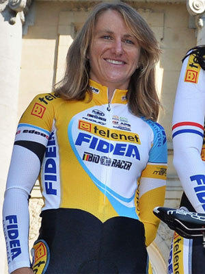 American bicycle racer Amy Dombroski, shown in a photo taken Tuesday for the Belgium-based Telenet-Fidea, died Thursday after being hit by a truck while training.