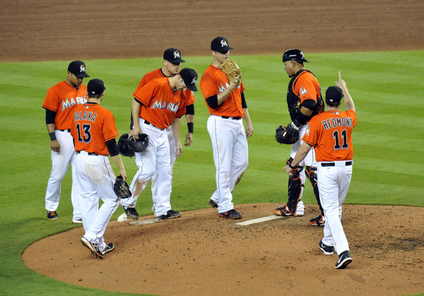 May 1, 2013; Miami, FL, USA; Miami Marlins manager Mike Redmond (11) signals for a pitching change in the sixth inning against the New York Mets at Marlins Park.