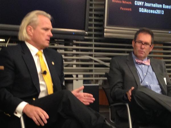 CFTC Commissioner Bart Chilton, left, speaks during a conference for business editors and writers in New York City.