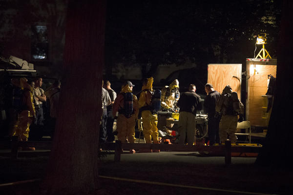 Hazardous materials personnel prepare to enter the apartment complex where Miriam Carey lived in Stamford, Conn.