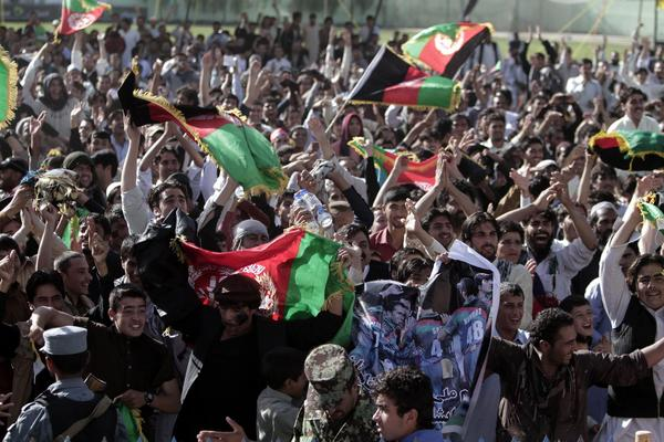 Afghan cricket fans in Kabul celebrate their team's victory in the match between Afghanistan and Kenya on Friday.