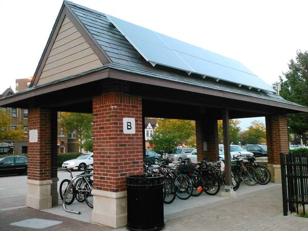 The small, brick bike shelter near the downtown Arlington Heights Metra train station produces 2,100 kilowatts of solar power, officials said.