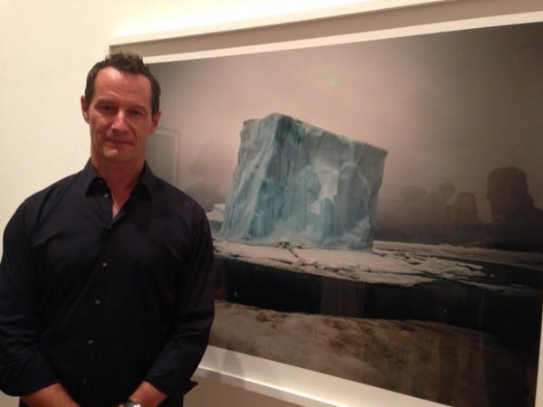 Sebastian Copeland poses in front of one of his North Pole photographs.