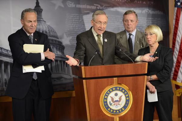 Senate Majority Leader Harry Reid (D-Nev.) second from left, with fellow Democratic Sens. Charles Schumer of New York, Dick Durbin of Illinois and Patty Murray of Washington, responds to a question about the partial government shutdown during a news conference Friday in the Capitol.