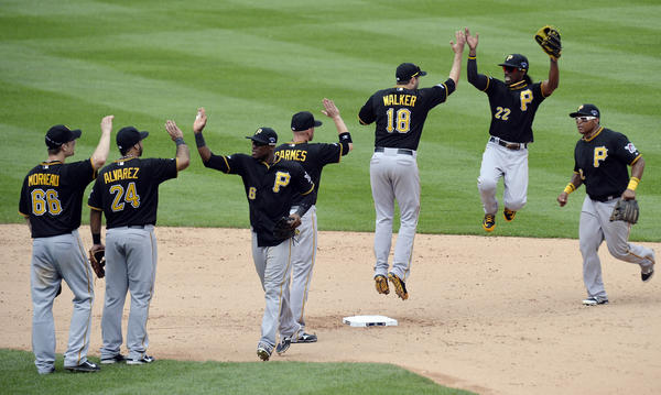 Members of the Pirates celebrate after game two of the National League divisional series game against the Cardinals.