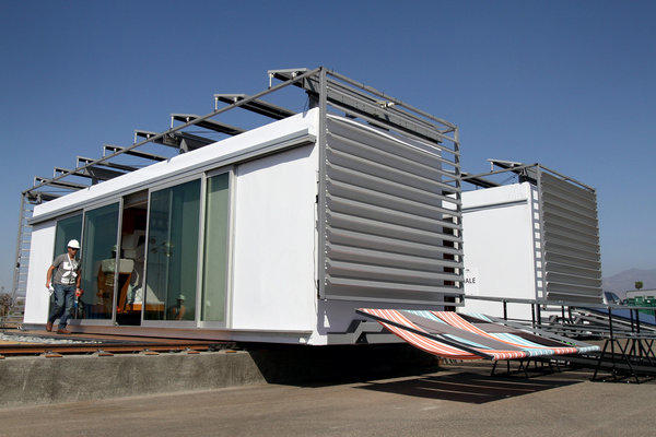 Santa Ana winds force the closing of the Solar Decathlon. Above, a photo of the SCI-Arc and Caltech house from earlier this week.