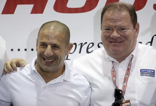 Chip Ganassi, right, with driver Tony Kanaan at a news conference on Friday.