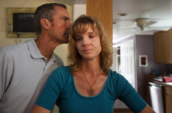 Jim Garner kisses his wife, Karen, as she talks about the isolation her family has begun to feel as a result of Jim's diagnosis of early-onset Alzheimer's disease.