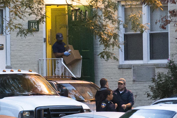 A federal agent removes evidence from the apartment complex where Miriam Carey lived in Stamford, Conn.