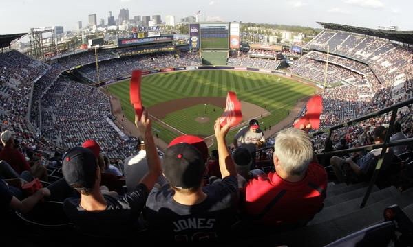 Atlanta Braves fans cheer on their team during Game 2 of the National League division series against the Dodgers on Friday.