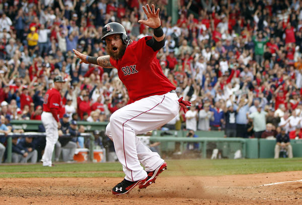 Boston Red Sox left fielder Jonny Gomes reacts after scoring a run during the fourth inning.