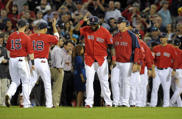 The Red Sox celebrate the Game 1 win.