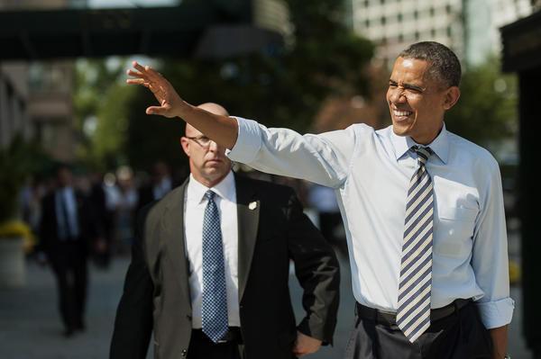 President Obama waves to bystanders on his way to pick up lunch in Washington.