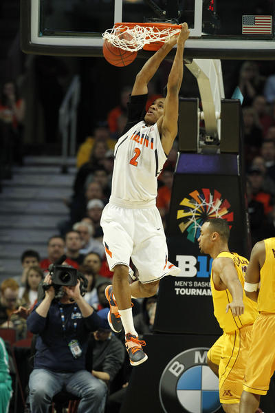 Joseph Bertrand dunks against Minnesota in the first half of of a Big Ten tournament game.