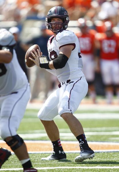 Southern Illinois quarterback Kory Faulkner drops back to pass against Illinois.