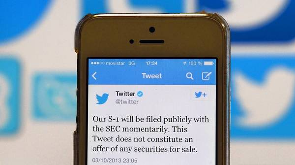 A tweet announcing Twitter's initial public offering (IPO) is pictured on a telephone in Madrid. More than three-quarters of the company's active monthly users are from outside the U.S. With the IPO announcement, pressure will increase for the company to ramp up its global advertising business.