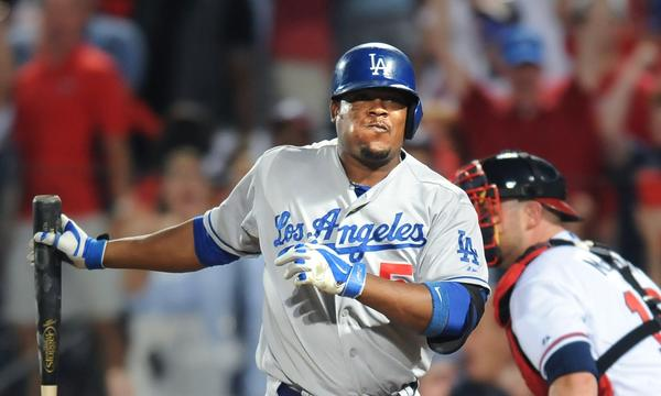 Dodgers third baseman Juan Uribe strikes out with two runners on base during the sixth inning of the Dodgers' 4-3 loss to the Atlanta Braves in Game 2 of the National League division series Friday.