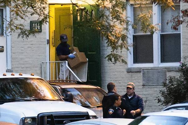A federal agent takes evidence from an apartment where Miriam Carey lived in Stamford, Conn. She was killed by police after a confrontation with officers and the Secret Service and a car chase in Washington, D.C.