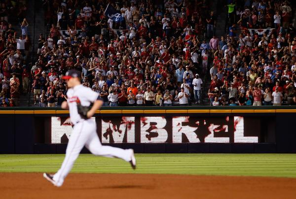 Braves closer Craig Kimbrel enters the game as a sign shows his name in flames in the ninth inning against the Dodgers.