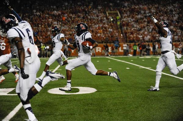 Mississippi Rebels running back Jeff Scott (3) returns a punt for a touchdown against the Texas Longhorns.