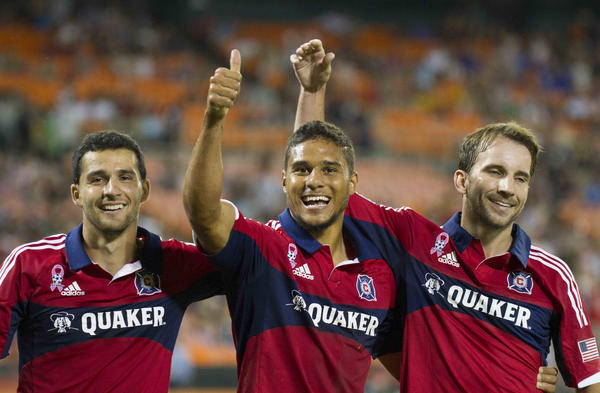 Quincy Amarikwa (center) celebrates with Mike Magee (right) and Dilly Duka after scoring a goal against D.C. United during the second half.