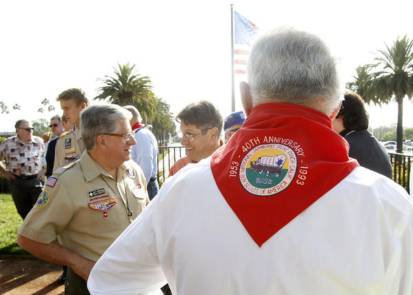 Members past and present including Larry Locy with red scarf, gather to remember the 1953 Boy Scouts of America Jamboree during 50th anniversary celebration that took place at Fashion Island on Thursday. The area was formerly Irvine Ranch land.