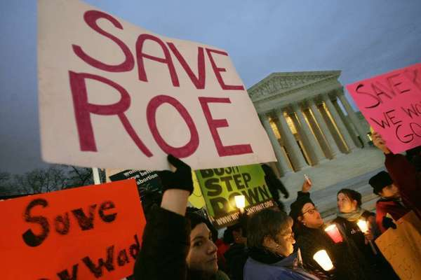 The U.S. Supreme Court will soon consider a handful of cases on controversial issues, including abortion. Above, pro-choice supporters hold a candlelight vigil in front of the Supreme Court building in 2005.