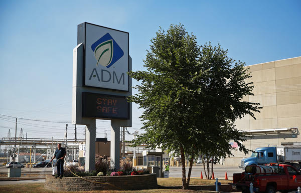A worker gives a chemical treatment to entrance lawn of the Archer Daniels Midland Company headquarters Thursday, Sept. 26, 2013, in Decatur, Ill.