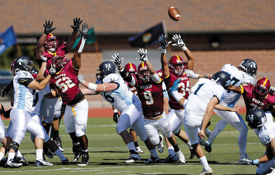 Northern State University defenders try to block the kick of Upper Iowa's Gustavo Rocha (1) during Saturday's game at Swisher Field. photo by john davis taken 9/21/2013