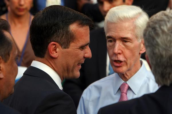 Former California Gov. Gray Davis, right, talks with Los Angeles Mayor Eric Garcetti at the mayor's inauguration ceremony.