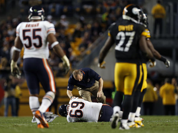 Henry Melton is injured during 40-23 win over the Steelers.